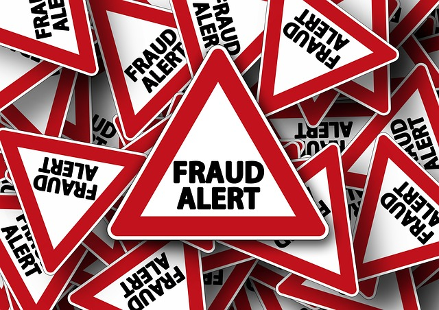 tax identity fraud alert with caution signs