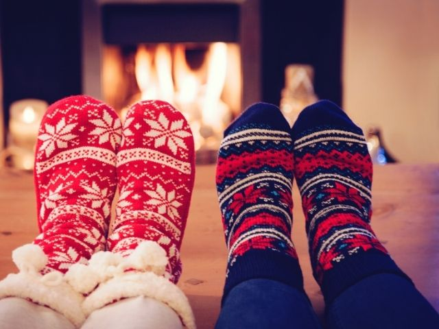 Christmas Shopping and budgeting tips with couple in ugly sweater socks