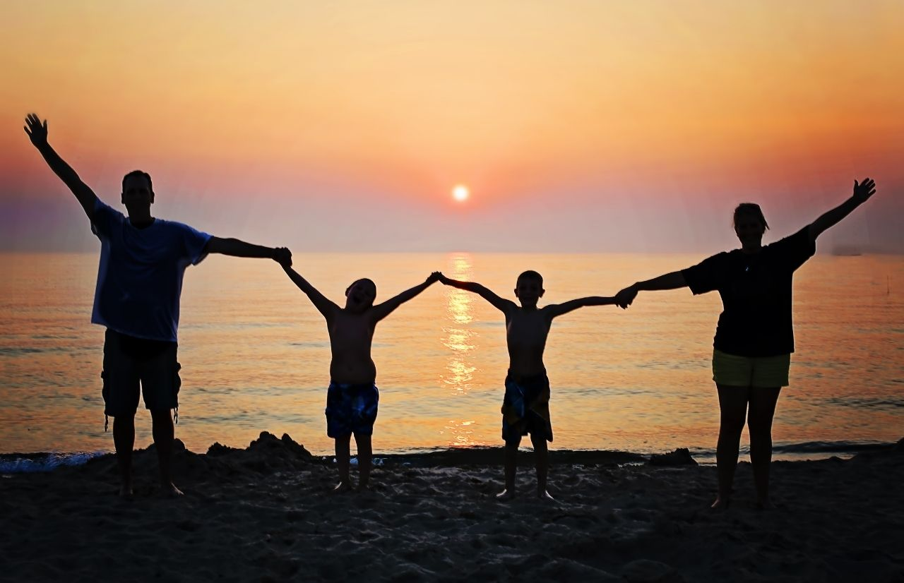 Child Tax Credit with family in sunset over ocean